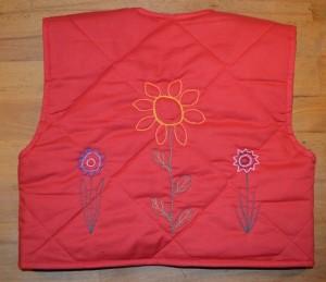 rød quiltet vest bag